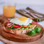 Avocado Toast with Heirloom Tomatoes Basil Egg and Bacon